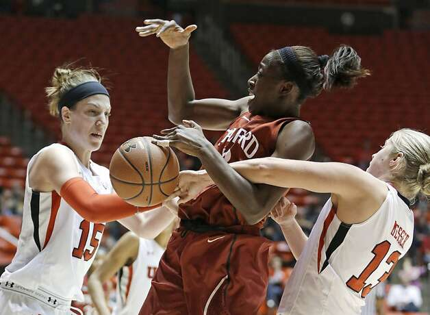 At right, Chiney Ogwumike is fouled by Rachel Messer (right) as Michelle Plouffe also defends during Stanford's 70-56 victory at Utah. The Bears host the Cardinal on Tuesday. B7 Photo: Rick Bowmer, Associated Press