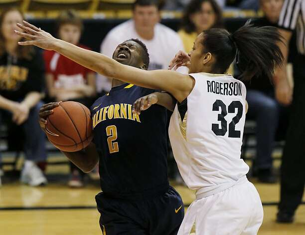 Afure Jemerigbe, No. 2 at left, keeps the ball from Arielle Roberson in Cal's 53-49 win at Colorado. Photo: David Zalubowski, Associated Press