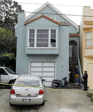 "San Francisco police enter the home of a woman who was set on fire Sunday, Jan. 6, 2013, in San Francisco. San Francisco police say a woman is hospitalized with what are being described as ""life-threatening injuries"" after someone poured a flammable liquid on her and set her on fire.  (AP Photo/Ben Margot) Photo: Ben Margot, Associated Press"