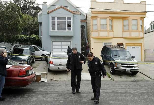 "San Francisco police officers search for evidence and guard the home of a woman who was set on fire Sunday, Jan. 6, 2013, in San Francisco. San Francisco police say a woman is hospitalized with what are being described as ""life-threatening injuries"" after someone poured a flammable liquid on her and set her on fire. Police spokesman Officer Carlos Manfredi says officers were called to the city's Bayview District a little after noon by people who reported a woman screaming. When officers arrived they found a women suffering from what Manfredi described as ""severe burns."" The woman, believed to be in her 20s, was taken to a hospital where she is being treated at a burn center. Her name has not been released. Police did not immediately release any suspect information. (AP Photo/Ben Margot) Photo: Ben Margot, Associated Press"