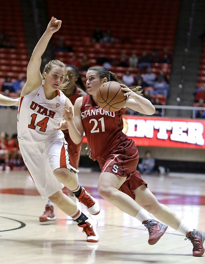 Sara James (right) eyes the target as she drives against Utah's Paige Crozon in Stanford's grind-it-out road victory. Photo: Rick Bowmer, Associated Press