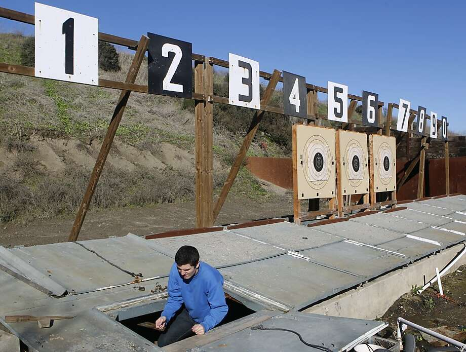 "After setting targets for a training session, James Macmillan of Kentfield emerges from ""the pit"" at the Richmond Rod & Gun Club. Macmillan, 20, has won a national title for Cuesta College in San Luis Obispo County. Photo: Paul Chinn, The Chronicle"