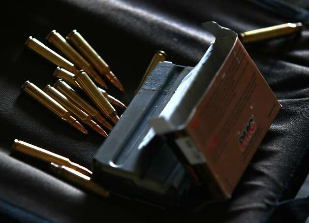 The ammo for Macmillan's AR-15 semiautomatic rifle is strictly for a high- powered weapon. He says that hunting has never interested him. Photo: Paul Chinn, The Chronicle
