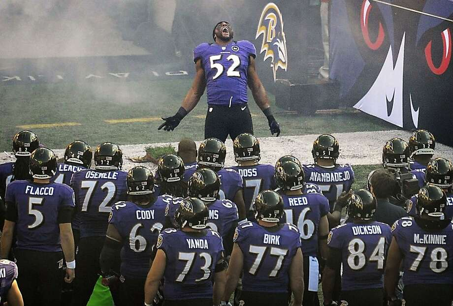Ray Lewis, who says he'll retire after the playoffs, performs his pregame ritual before Baltimore's win over the Colts. Lewis got another chance to strut after his team's victory. Photo: Gene Sweeney Jr., McClatchy-Tribune News Service