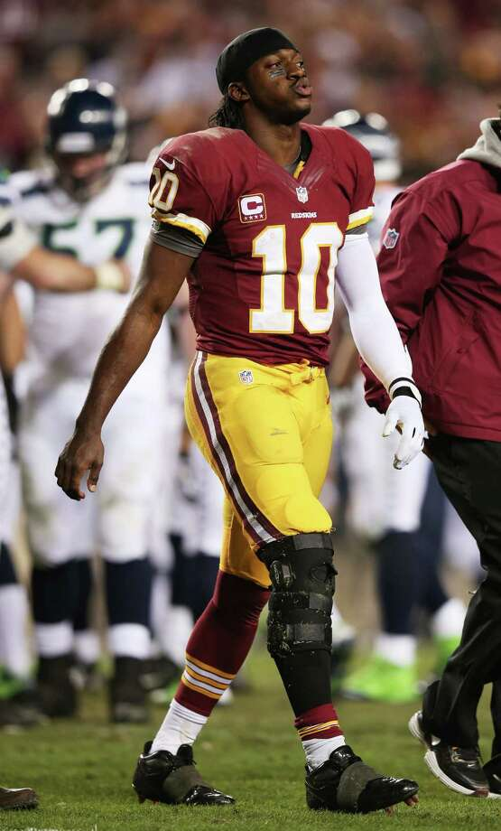 Robert Griffin III #10 of the Washington Redskins leaves the field injured during their 24 to 14 loss to the Seattle Seahawks in the NFC Wild Card Playoff Game at FedExField on January 6, 2013 in Landover, Maryland. Griffin was injured during the game. Photo: Win McNamee, Getty Images / 2013 Getty Images