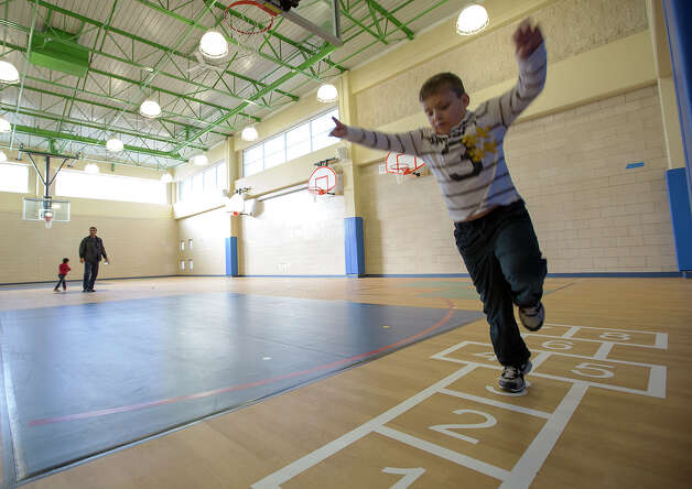 Mason Oberlin, 7, plays hopscotch during an open house at Vineyard Ranch Elementary School on Sunday, Jan. 6, 2013. Photo: Michael Miller, San Antonio Express-News / San Antonio Express-News