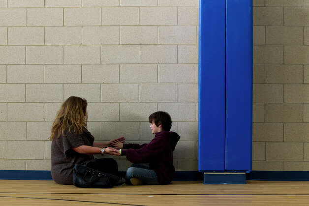 Sandra Murray plays a game with her son, Brendan, 8, during an open house at Vineyard Ranch Elementary School on Sunday, Jan. 6, 2013.  Photo: Michael Miller, San Antonio Express-News / San Antonio Express-News