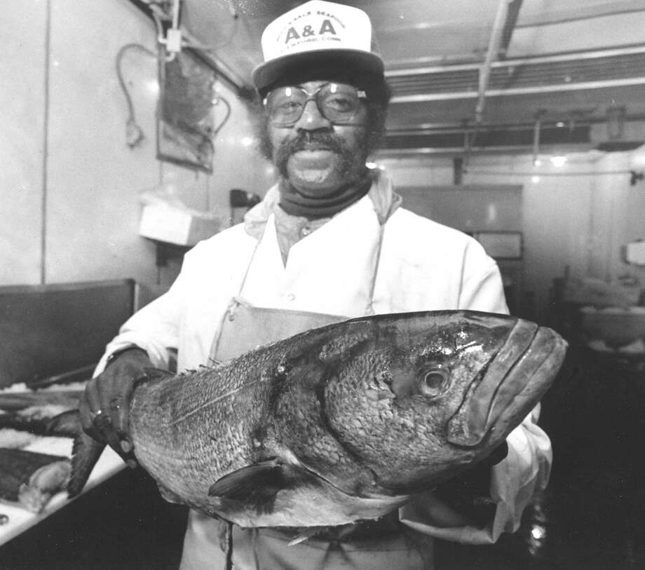 As the city suffered a deep freeze, John Elliot shows off a prime specimen at A&A Seafood on Jan. 6, 1988. Workers at the business said the cold weather made the seafood easier to handle. Photo: Advocate