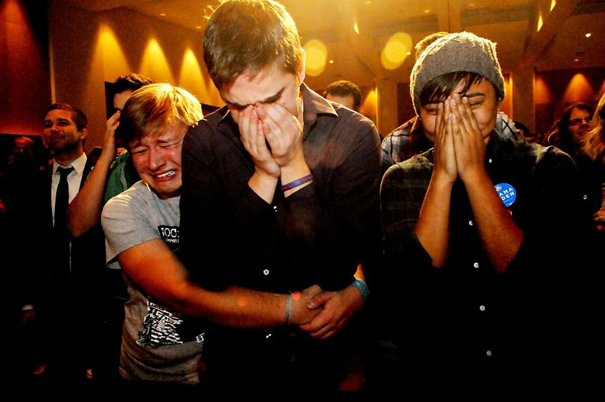 FILE - In this Nov. 7, 2012, file photo, Anthony Streiff, left, Alex Sand and Nam Dorjee, all from Minneapolis, are in tears when it is announced that voters had rejected a proposed amendments to Minnesota's Constitution, to ban gay marriage, at an Minnesotans United for All Families election night event in St. Paul, Minn. Same Sex marriage was among the top stories of the year in Minnesota. (AP Photo/Pioneer Press, Jean Pieri-File) MINNEAPOLIS STAR TRIB OUT MPLS OUT NO MAGS MANDATORY CREDIT