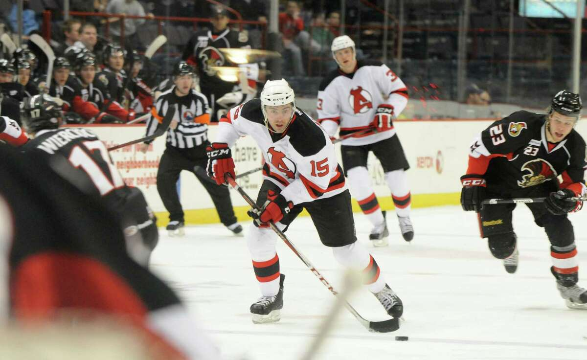 Steve Zalewski of the Albany Devils, center, advances towards the Binghamton Senators goal, Sunday evening, Jan. 6, 2013, during the second period at the Times Union Center in Albany, N.Y. (Will Waldron/Times Union)