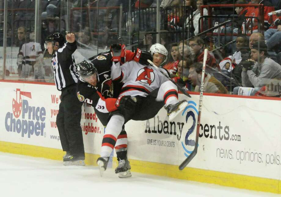 Binghamton?s Eric Gryba, left, collides with Chris McKelvie of the Albany Devils, Sunday evening, Jan. 6, 2013, during the second period at the Times Union Center in Albany, N.Y. (Will Waldron/Times Union) Photo: Will Waldron