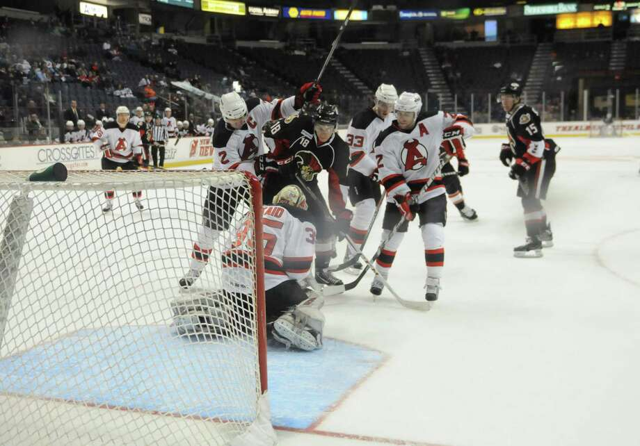 Albany Devils goalie Keith Kinkaid secures the puck after making a save during the third period against the Binghamton Senators, Sunday evening, Jan. 6, 2013, at the Times Union Center in Albany, N.Y. (Will Waldron/Times Union) Photo: Will Waldron