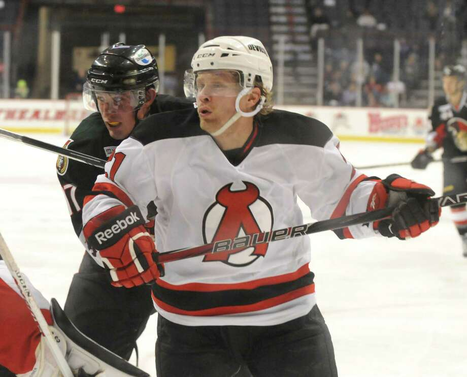 Mattias Tedenby of the Albany Devils, right, during the second period against the Binghamton Senators, Sunday evening, Jan. 6, 2013, at the Times Union Center in Albany, N.Y. (Will Waldron/Times Union) Photo: Will Waldron