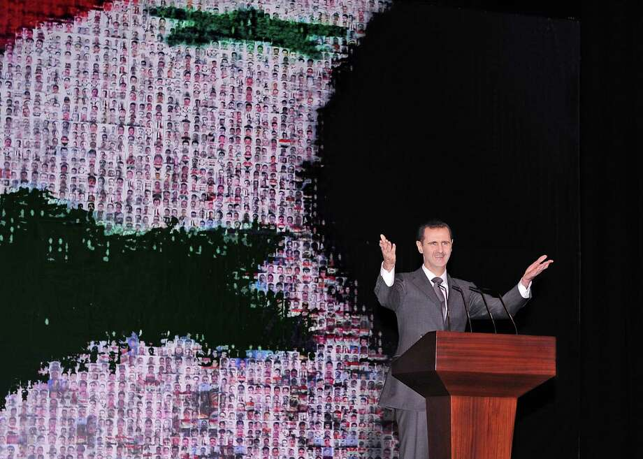 Syrian President Bashar Assad on Sunday outlined a new peace initiative but demanded regional and Western countries stop funding and arming rebels first. Photo: HOPD / SANA