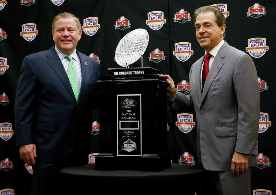 Alabama head coach Nick Saban and Notre Dame head coach Brian Kelly pose with The Coaches' Trophy during a news conference for the BCS National Championship college football game Sunday, Jan. 6, 2013, in Miami. (AP Photo/John Bazemore) Photo: John Bazemore