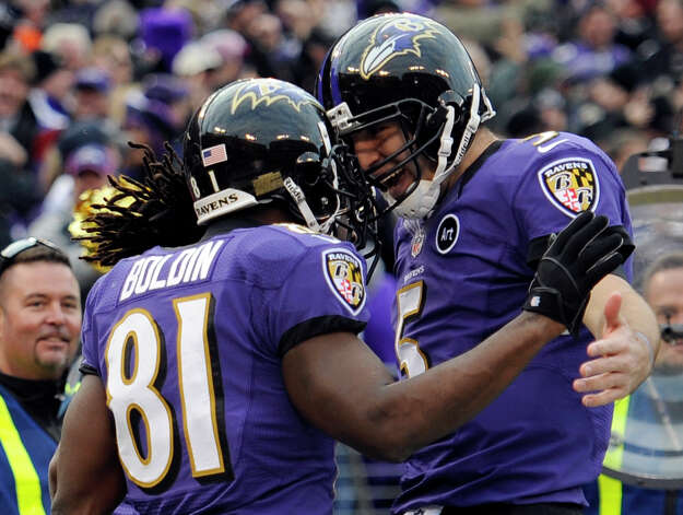 Baltimore Ravens wide receiver Anquan Boldin (81) celebrates his touchdown catch with quarterback Joe Flacco (5) during the second half of an NFL wild card playoff football game against the Indianapolis Colts Sunday, Jan. 6, 2013, in Baltimore. (AP Photo/Nick Wass) Photo: Nick Wass