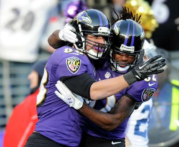 Baltimore Ravens tight end Dennis Pitta (88) and wide receiver Torrey Smith (82) celebrate Pitta's touchdown during the second half of an NFL wild card playoff football game against the Indianapolis Colts Sunday, Jan. 6, 2013, in Baltimore. (AP Photo/Nick Wass) Photo: Nick Wass