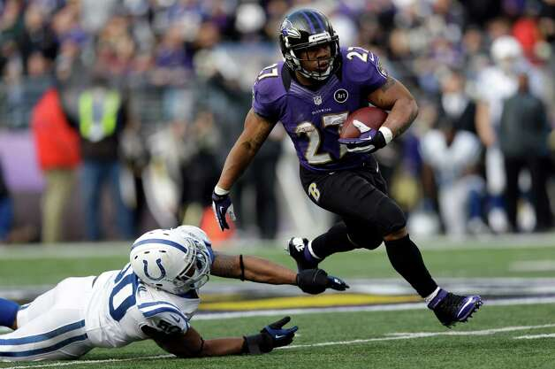 Baltimore Ravens running back Ray Rice (27) runs with the ball and gets away from Indianapolis Colts inside linebacker Jerrell Freeman (50), for a 47 yard gain, during the first half of an NFL wild card playoff football game Sunday, Jan. 6, 2013, in Baltimore. (AP Photo/Patrick Semansky) Photo: Patrick Semansky