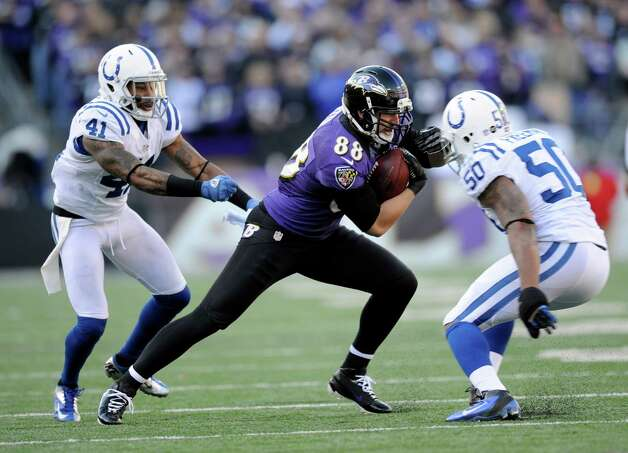 Baltimore Ravens tight end Dennis Pitta (88) tries to get away from Indianapolis Colts free safety Antoine Bethea (41) and inside linebacker Jerrell Freeman (50) during the first half of an NFL wild card playoff football game Sunday, Jan. 6, 2013, in Baltimore. (AP Photo/Nick Wass) Photo: Nick Wass