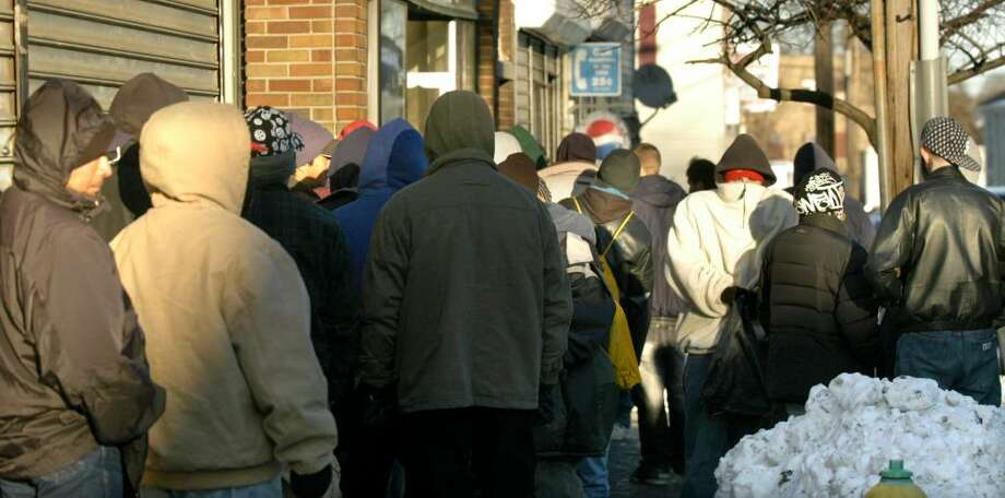 People bundled up from the cold, waiting in line for the doors to open at the Dorothy Day Hospitality House on Spring St. in Danbury for the afternoon meal Monday, Dec. 21, 2009 Photo: Carol Kaliff / The News-Times