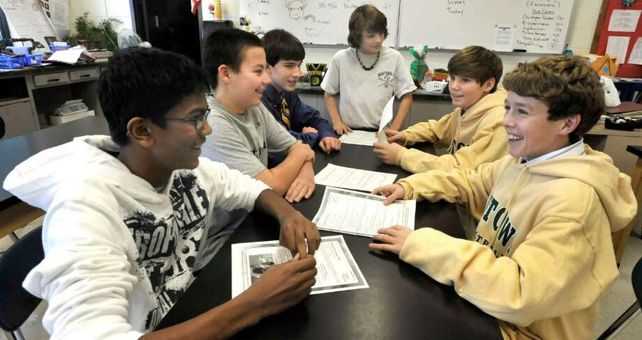 Eighth grade students at Newtown Middle School discussing future Lexus Eco Challange project, include, from left: Vivek Tedla, Austin Raftery, Wesley Morlock, Garrison Buzzanca, Mike Davis and Matthew Mossbarger. They met on Tuesday, Dec.22,2009. Photo: Michael Duffy / The News-Times