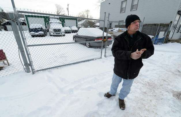 Jack Cox Jr. stands by his  family business Jan. 4, 2012, on 5th Avenue in Troy, N.Y. between 113th and 114th street.   (Skip Dickstein/Times Union) Photo: SKIP DICKSTEIN