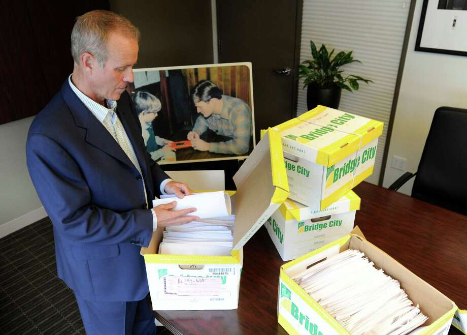 In a Tuesday, Oct., 16, 2012 photo, Portland attorney Kelly Clark examines some of the 14,500 pages of previously confidential documents created by the  Boy Scouts of America concerning child sexual abuse within the organization, in preparation for releasing the documents Thursday, Oct. 18, as he stands in his office in Portland, Ore. The Boy Scouts of America fought to keep those files confidential.  (AP Photo/Greg Wahl-Stephens) Photo: Greg Wahl-Stephens / FR29287 AP