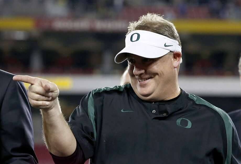 Chip Kelly, according to several reports, will stay at Oregon after interviewing with NFL teams. Photo: Ross Franklin, Associated Press