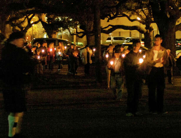 Church members and guests carry candles in a procession concluding Sunday's Epiphany service at St. Mark's Episcopal Church. The candles were then used to light a ceremonial bonfire of Christmas evergreens during a ceremonial bonfire known as the Burning of the Greens. Photo: Sarah Moore