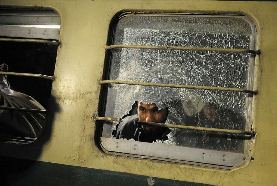 A Pakistani man looks through a broken mirror on the Jaffar Express train after an attack at a railway station in Quetta on early 6, 2012. Unidentified gunmen fired at a train in Pakistan's restive Baluchistan province, killing at least five people and seriously injuring 20 others. Photo: Banaras Khan, AFP/Getty Images