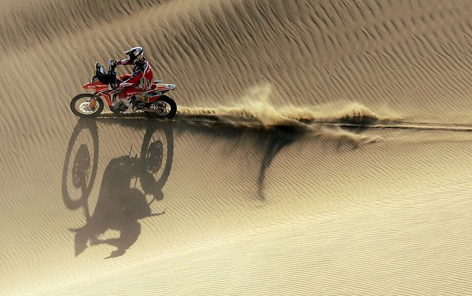 Honda's biker Javier Pizzolito of Argentina competes during the Stage 2 of the Dakar 2013 in Pisco, Peru, on January 6, 2013. The rally will take place in Peru, Argentina and Chile from January 5 to 20. Photo: Franck Fife, AFP/Getty Images