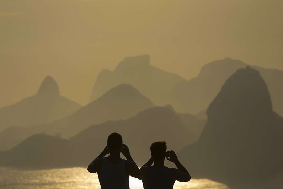 A sunset in Rio de Janeiro inspires a couple of amateur photographers. Photo: Felipe Dana, Associated Press