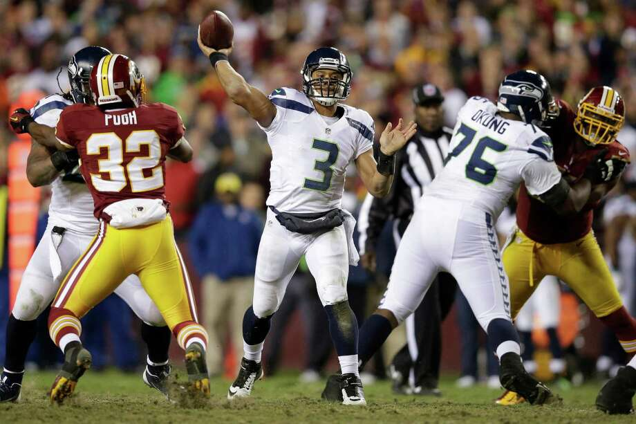 Seattle Seahawks quarterback Russell Wilson passes the ball during the second half of an NFL wild card playoff football game against the Washington Redskins in Landover, Md., Sunday, Jan. 6, 2013. Photo: AP