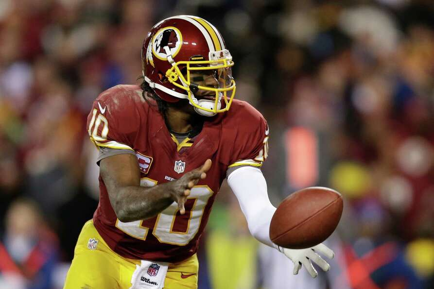 Washington Redskins quarterback Robert Griffin III tosses the ball during the second half of an NFL