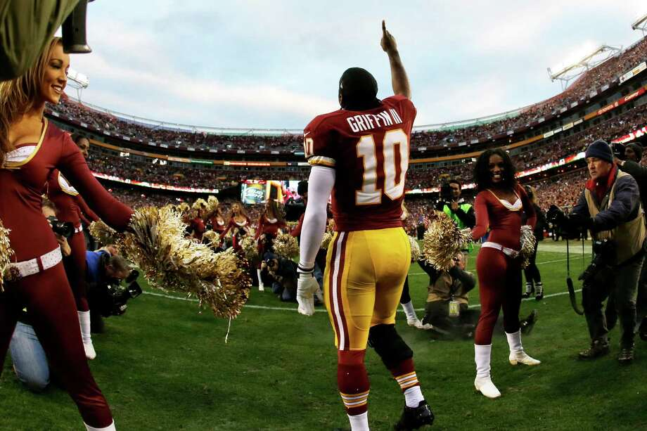 Washington Redskins quarterback Robert Griffin III runs onto the field before the first half of an NFL wild card playoff football game against the Washington Redskins in Landover, Md., Sunday, Jan. 6, 2013. Photo: AP