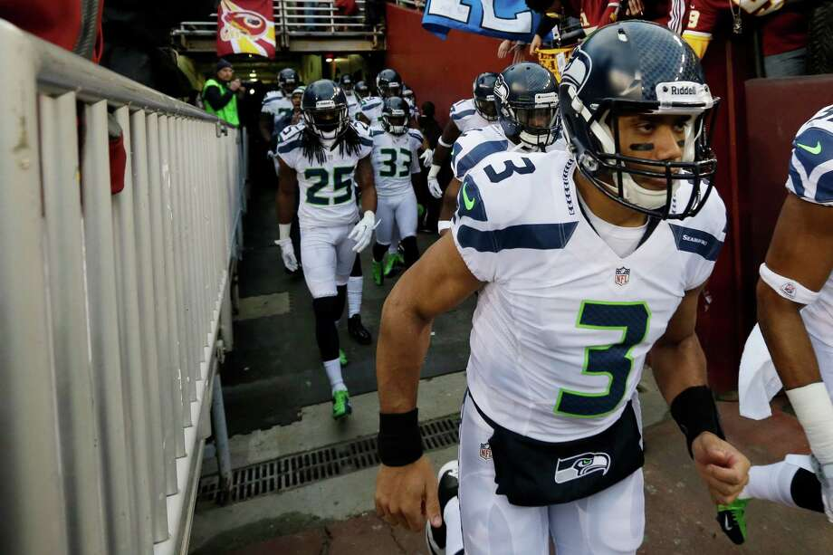 Seattle Seahawks quarterback Russell Wilson runs onto the field before the first half of an NFL wild card playoff football game against the Washington Redskins in Landover, Md., Sunday, Jan. 6, 2013. Photo: AP