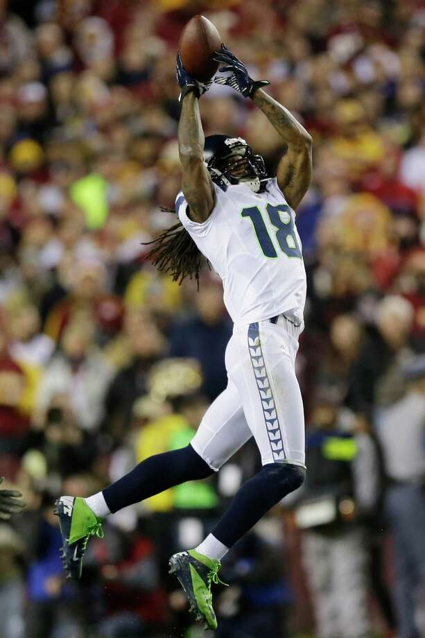 Seattle Seahawks wide receiver Sidney Rice pulls in a pass during the first half of an NFL wild card playoff football game against the Washington Redskins in Landover, Md., Sunday, Jan. 6, 2013. Photo: AP