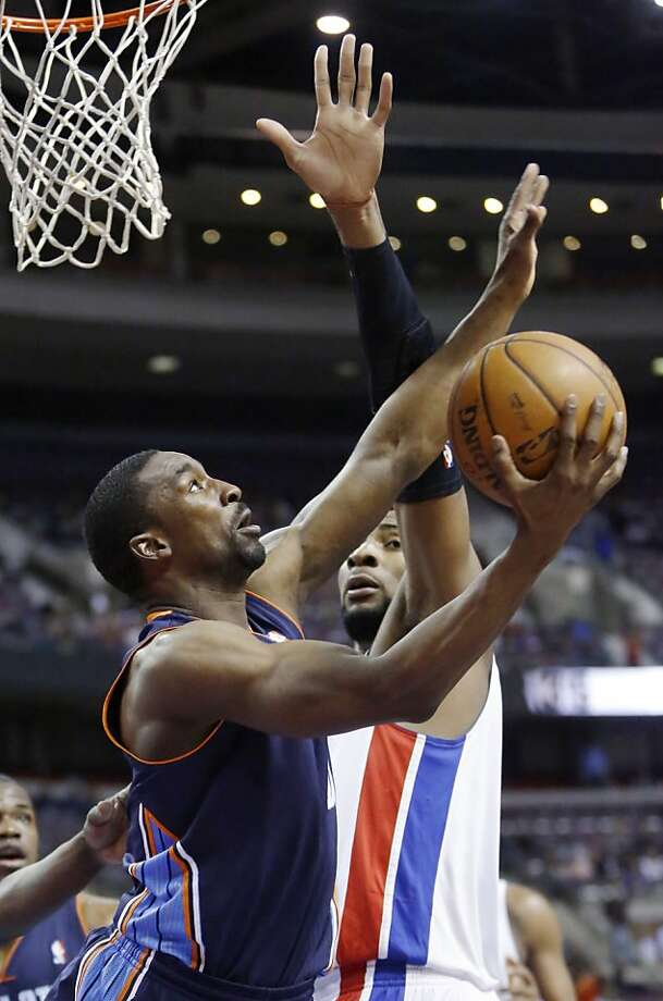 Charlotte guard Ben Gordon gets off a shot against Detroit center Andre Drummond. Photo: Duane Burleson, Associated Press