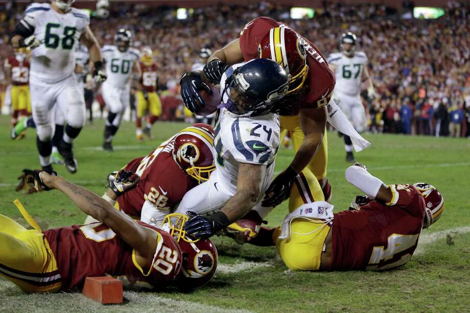 Seattle Seahawks running back Marshawn Lynch tumbles in the end zone for a touchdown during the second half of an NFL wild card playoff football game against the Washington Redskins in Landover, Md., Sunday, Jan. 6, 2013. The Seahawks defeated the Redskins 24-14. Photo: AP