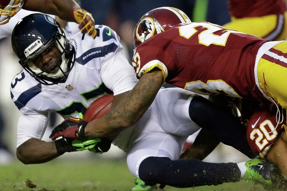 Seattle Seahawks running back Leon Washington is stopped by Washington Redskins cornerback DeAngelo Hall during the first half of an NFL wild card playoff football game in Landover, Md., Sunday, Jan. 6, 2013. Photo: AP