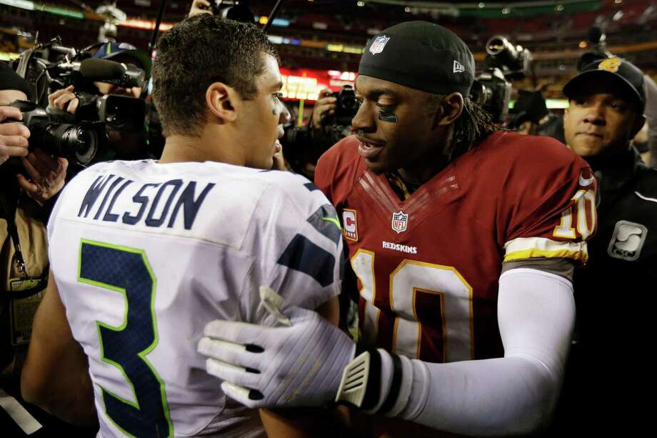 Seattle Seahawks quarterback Russell Wilson greets Washington Redskins quarterback Robert Griffin III after an NFL wild card playoff football game in Landover, Md., Sunday, Jan. 6, 2013. The Seahawks defeated the Redskins 24-14. Photo: AP