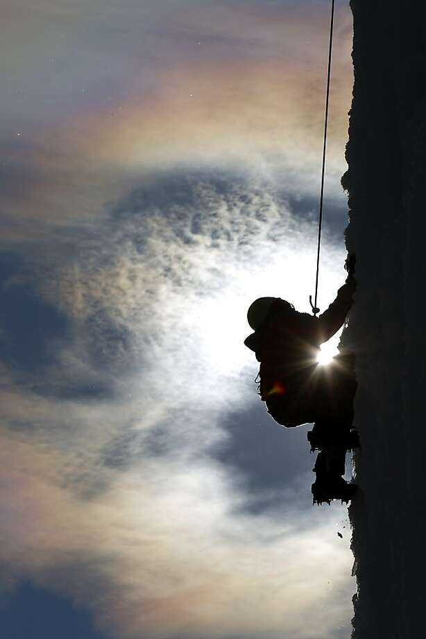 In this Saturday, Jan. 5, 2013, photo, Larame Boysen, 14, climbs an ice-covered silo on a farm west of Cedar Falls, Iowa. Climbers have been scaling the silo, an idea started by University of Northern Iowa physical education instructor Don Briggs, each winter since 2001. Photo: Matthew Putney, Associated Press