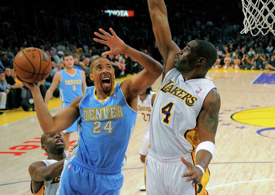 Nuggets guard Andre Miller (24) looks for an opening against Lakers forward Antawn Jamison. Photo: Mark J. Terrill, STF / AP