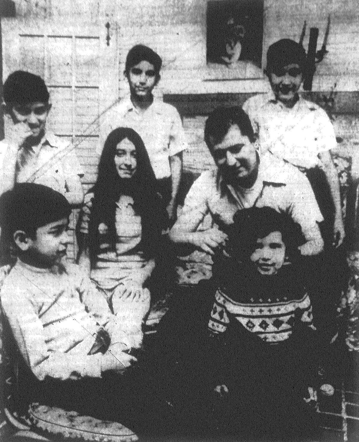 Michael Chapa Jr., a lieutenant inspector with the San Antonio Fire Department, combs daughter Leticia's hair, under the watchful eyes of his children Raul (foreground), Cynthia (next to Chapa), Frank (rear, from left), Gabriel and Michael. Chapa's wife, Virginia, died Dec. 21 in childbirth with the couple's seventh child. Christmas