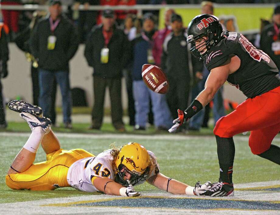 Arkansas State linebacker Nathan Herrold, right, stops a Kent State drive by intercepting a pass intended for Tim Erjavec. Photo: G.M. Andrews, FRE / FR 35697AP