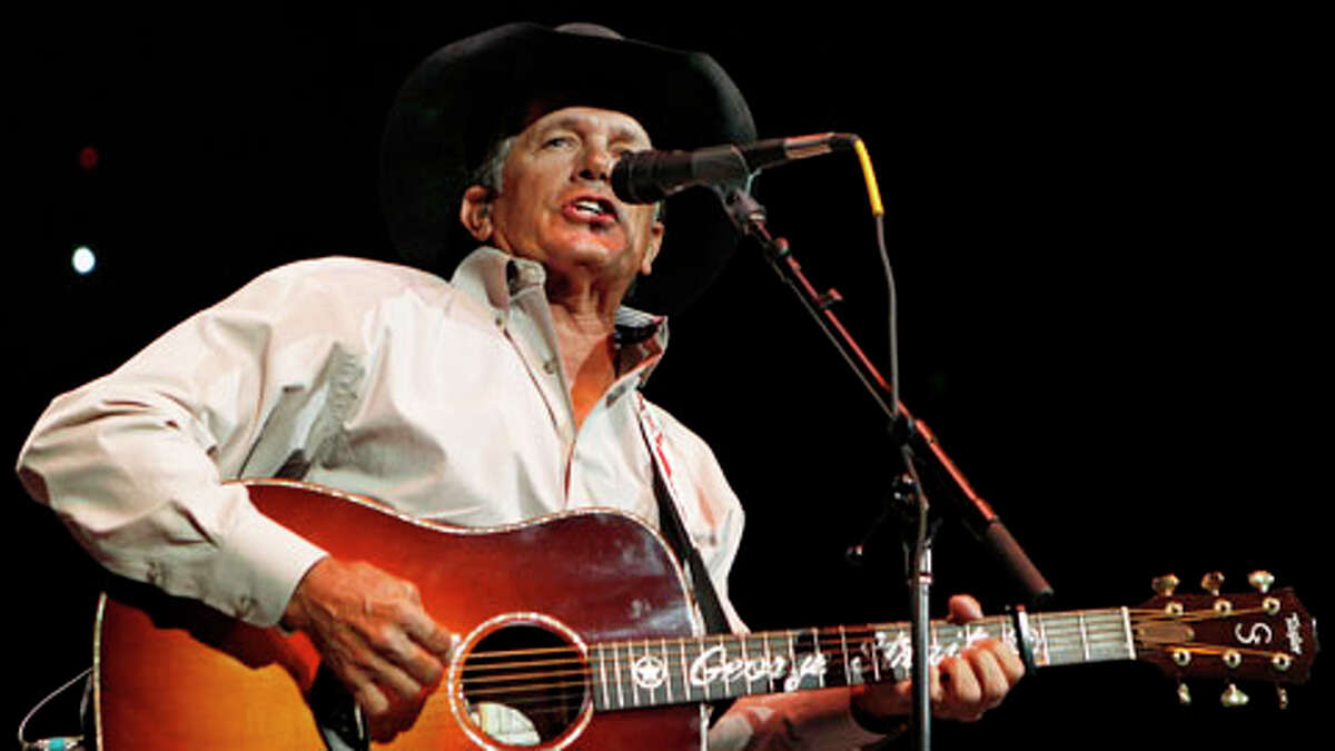 In this Oct. 17, 2011 file photo, George Strait performs during the Fire Relief, The Concert For Central Texas, at the Frank Erwin Center in Austin, Texas. The 60-year-old country music superstar on Wednesday, Sept. 26, 2012 announced that he'll embark on his final concert tour early next year. He made the announcement at a news conference at the Country Music Hall of Fame & Museum in Nashville, Tenn.