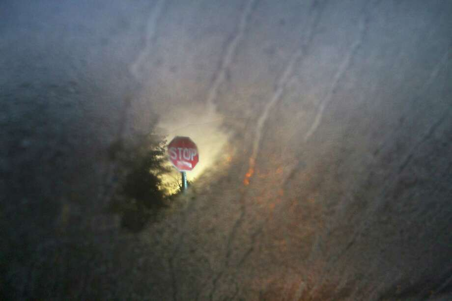 A stop sign is seen as frost forms on a windshield, Monday, Jan. 7, 2013, in Houston. Photo: Cody Duty, Houston Chronicle / © 2012 Houston Chronicle
