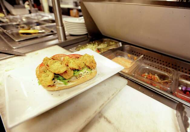 Executive Chef Frank Pannitti gives the final okay on an oyster po boy at Suga's Deep South Cuisine & Jazz Bar in Beaumont on Thursday, January 3, 2013. Photo taken: Randy Edwards/The Enterprise