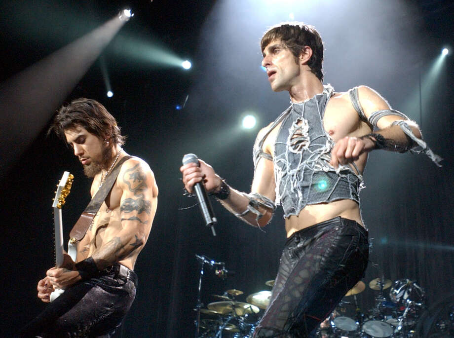 Jane's Addiction's Dave Navarro, left, and Perry Farrell perform with the band in this Aug. 9, 2003 file photo, during Lollapalooza 2003 at the Verizon Wireless Amphitheater in Selma, Texas. Photo: EDWARD A. ORNELAS, AP / SAN ANTONIO EXPRESS-NEWS