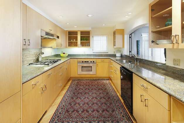 Custom cabinets and granite countertops are included in the kitchen. Photo: Steph Dewey, Reflex Imaging
